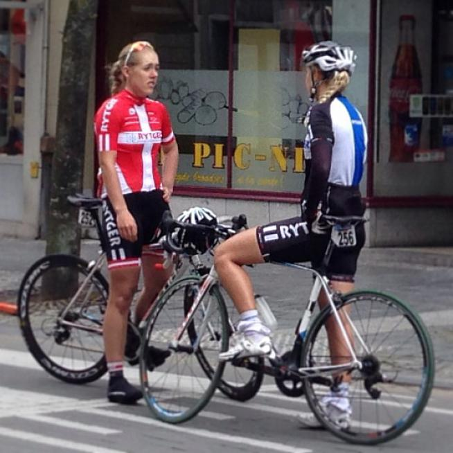 Two riders from the Women's Tour of Flanders chat in the town square after the race.