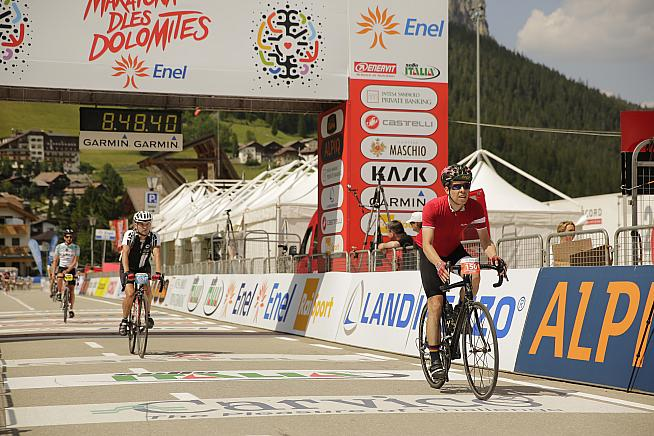 JSS crosses the line after a long day in the saddle at the Maratona (photo credit: Sportograf.com)