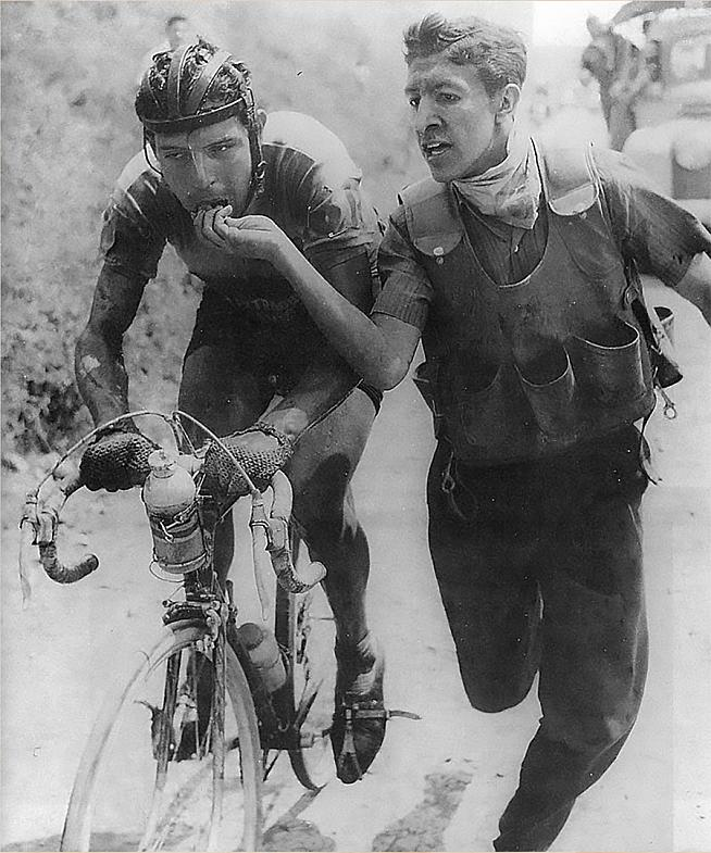 Colombian rider Ricardo Ovalle being fed bocadillo during the Vuelta a Colombia in the early 60s.