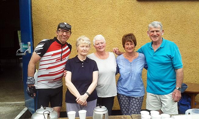 The writer with the real heroes of the race - the tea ladies of Calder Bridge with their apprentice.