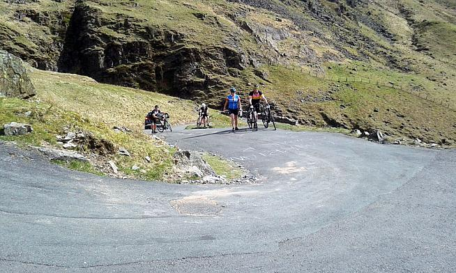 Walkers outnumbered riders on the 30% ramps of Hardknott.
