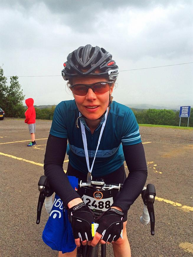 The victorious face of a woman who has just ridden 98.86 miles. Photo: Olly Townsend