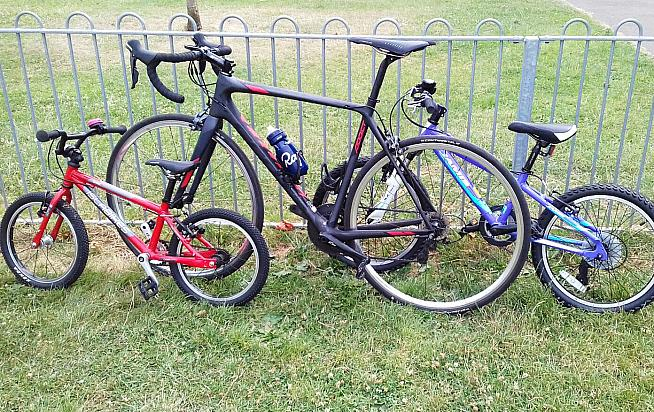 Dan's Scott Addict (centre) is a lightweight climbing machine.