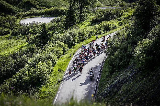 A bunch speeds up another climb. Photo: Sportograf