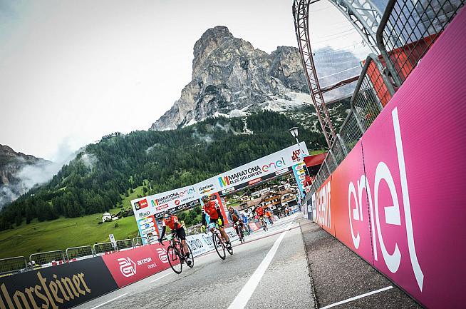 Riders cross the finish line in Alta Badia. Photo: Sportograf