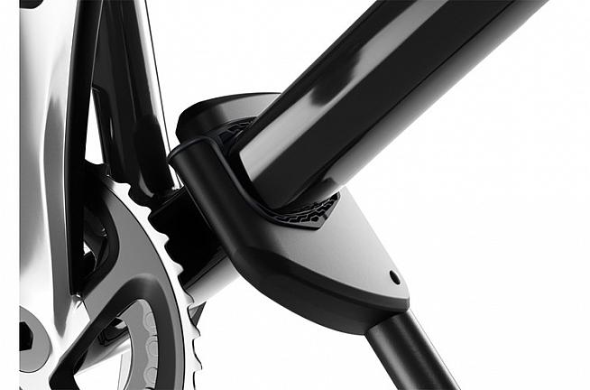 The clamp has padded jaws to protect your frame and springs open to release the bike.