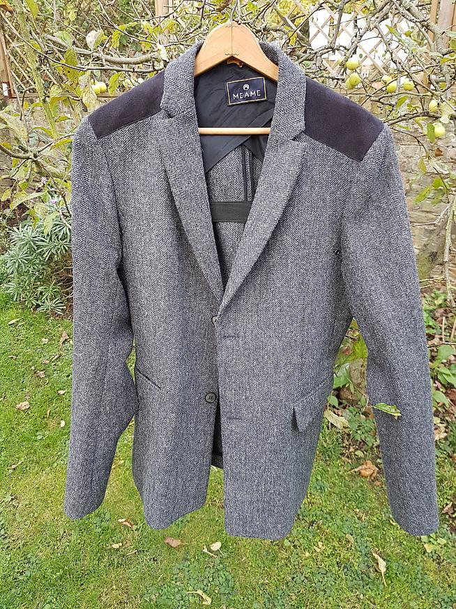 The front of the Meame tweed jacket.