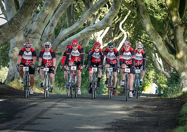 Riders pass through The Dark Hedges made famous by Game of Thrones.