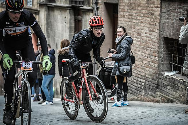 Emmie tackles the Strade Bianche's final climb in the streets of Siena. Photo: Sportograf