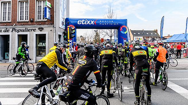 Riders approach the start arch for the Gent-Wevelgem Cycle. Credit: Etixx Classics Tour