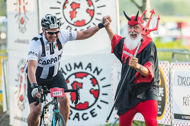Le Tour superfan Didi The Devil was on hand to greet finishers.