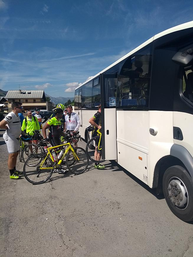 Trying to fit 18 people plus their bikes into a small bus