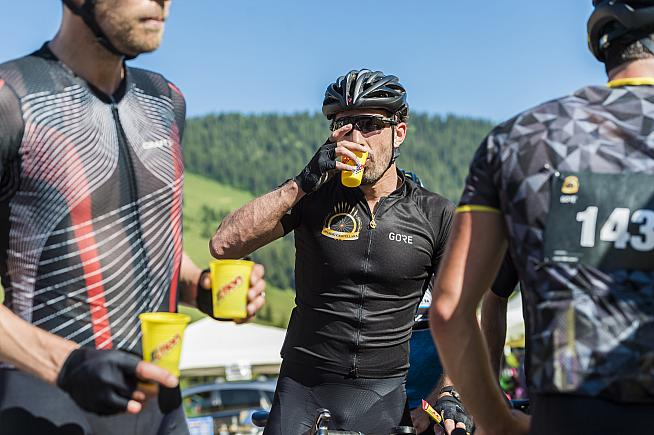 A well earned drink for Cancellara as he awaits fellow riders. Phil Gale / Emmie Collinge
