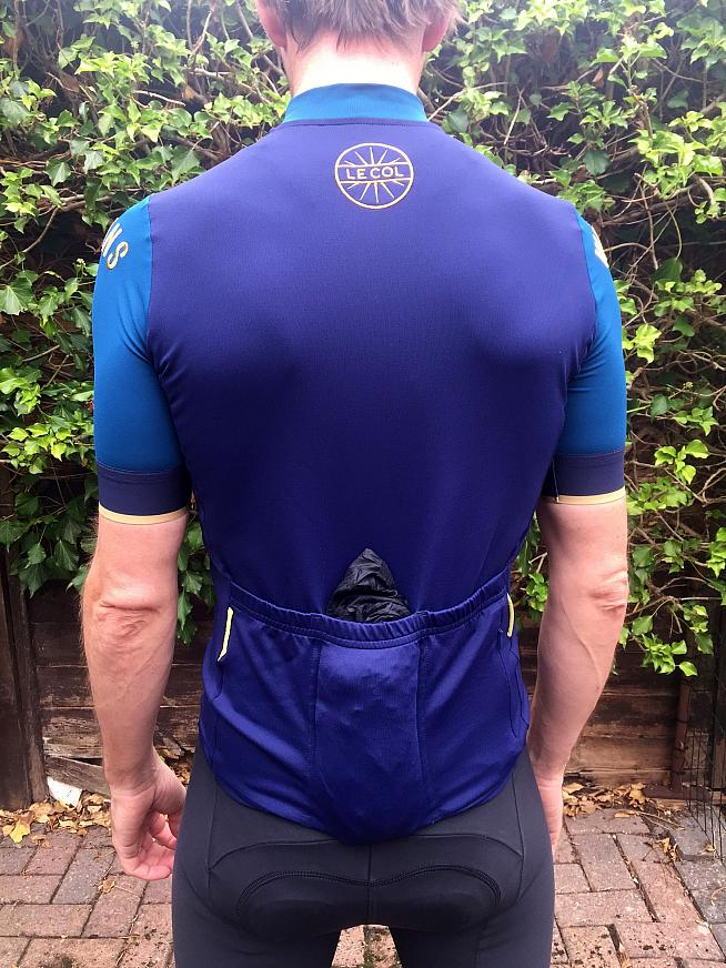 Embroidered logos and spacious rear pockets.