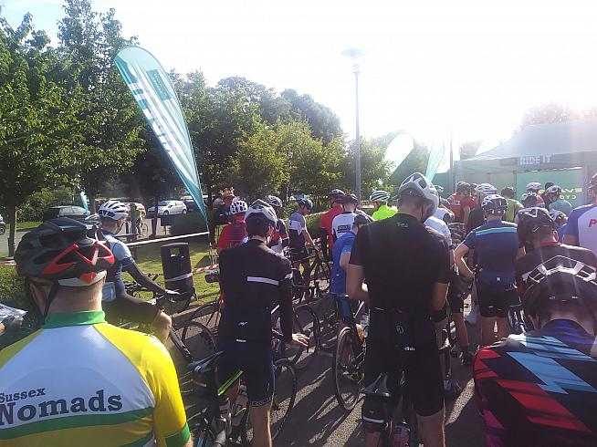 Riders muster for the start near Evans headquarters.