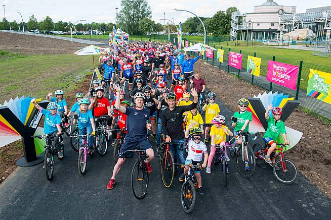 It's behind you! Ed Clancy joins children and dignitaries for the launch of Doncaster Cycle Track - with cobbled climb visible to the rear.