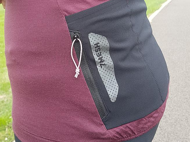 Zip pockets either side provide a secure place to stash valuables during the ride.