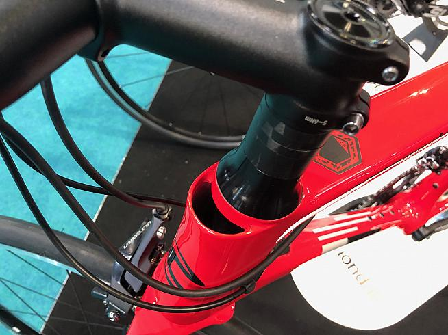 The unsightly gap at the front of the headtube is for routing cables when fitted with the aero integrated bars.
