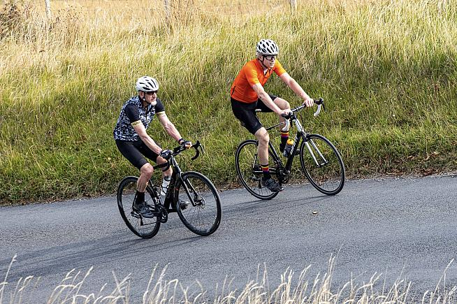 Dave paces Eoghan up another ascent on his Everesting challenge. Photo: Clive Jarman
