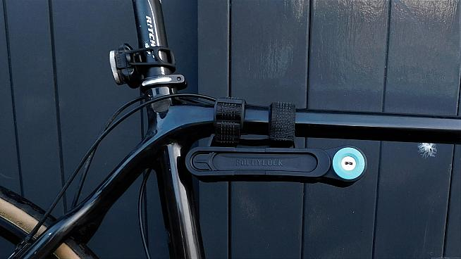The Foldylock can be carried on your bike's top tube...