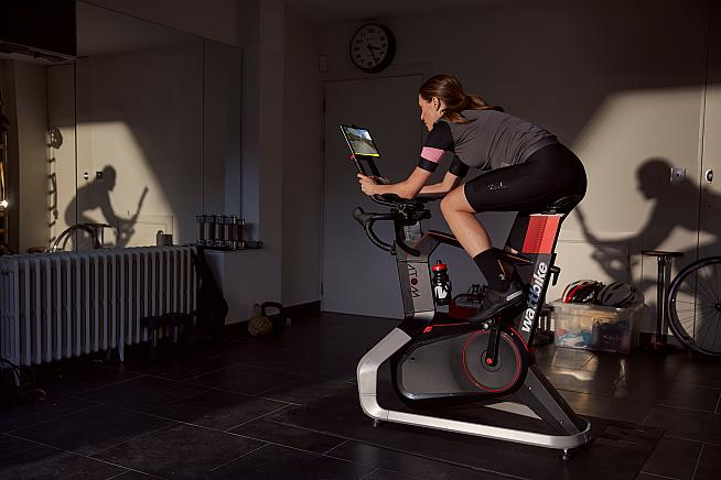 Ride and race real-world courses indoors with Wattbike and ROUVY.