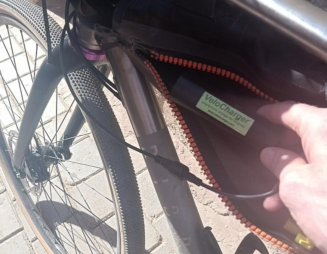 The VeloCharger can be attached to your frame - I chose to store it in a frame bag while touring.